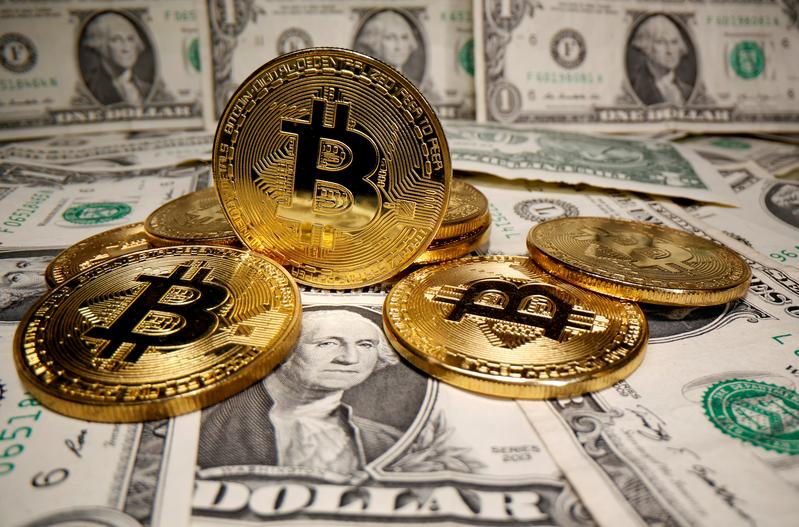 Bitcoin tops $50,000 as it wins more mainstream acceptance
